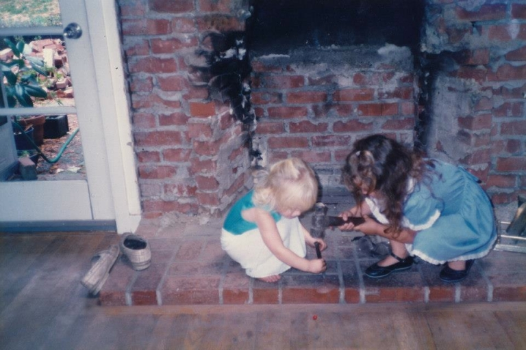 in 1989 our fireplace caved in from Loma Prieta earthquake.  I love that I told sara to hold the spike and she did.  WHat I love even more is that my dad's response to our activity was to take a picture, not to intervene.