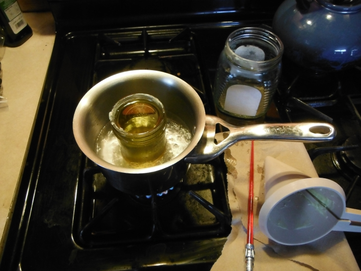 The recipe given will fit in a small mason jar.  I just use the jar in a pot for my double boiler.  I would not recommend putting the base in anything you intend to cook with later, it is a pain in the butt to clean and some of the oils linger.