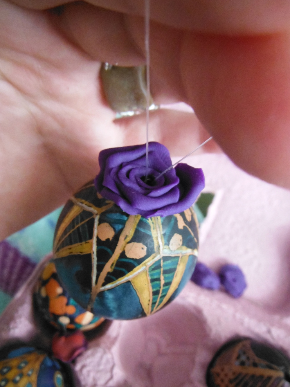 I made some flowers to thread through the line and cover the hole.