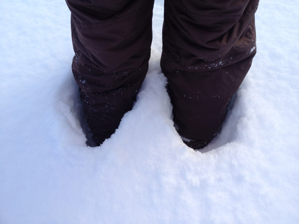 These are my knees.  Below them is a pair of snow boots (not pictured.)